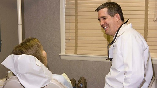 Dr. Jay McCarl smiling at dental patient