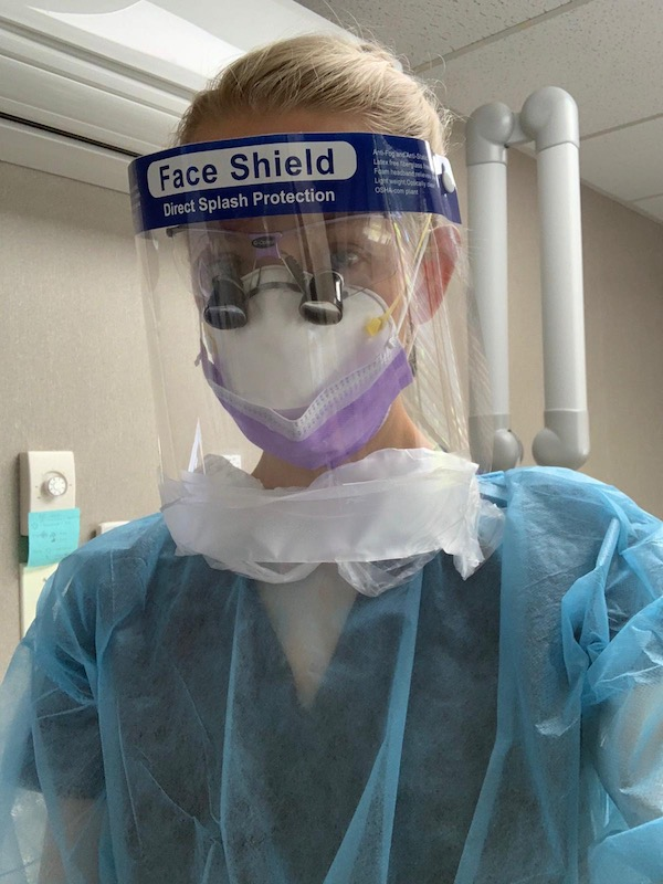 Dental team member wearing personal protective equipment